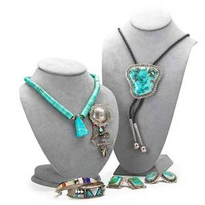 Native american sterling jewelry six items by hopi santo domingo and navajo artisans 20th c two bracelets two pair of earrings bolo tie and necklace together with a western style pin bracelet