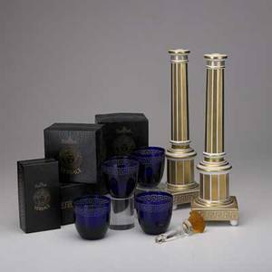 Versace rosenthal seven pieces 20th c pair of limited editions candlesticks four cobalt glass cups and figural amber glass stopper candlesticks 15 12
