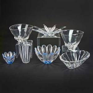 Orrefors steuben and baccarat seven glass pieces 20th c including starfish shaped centerpiece two orrefors lobed bowls two steuben bowls etc all marked tallest 8 14