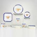 Chinese export style assembled set of dinnerware with eagle motif including punch bowl twenty cups twentyone saucers twelve luncheon plates two shellform plates three cutcorner square dishes