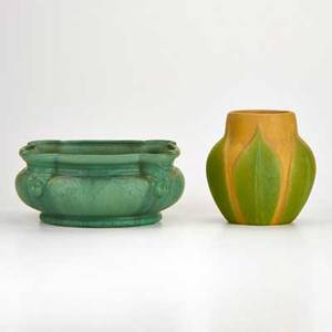 Weller attr green mat planter decorated with putti and yellow and green mat glaze vase decorated with impressed leaf motif both marked larger 10