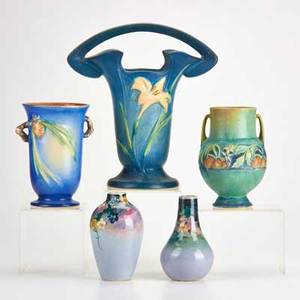 Roseville weller three roseville vases blue zephyr lily blue pinecone green baneda and two weller eocean vases roseville marked tallest 10 12