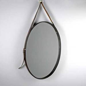 Style of jacques adnet oval mirror 1960s mirrored glass leather surround and strap unmarked 24 x 16