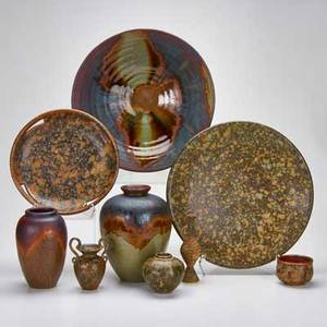 Judy glasser hiroshi nakayama nine studio pottery pieces large bowl two platters three vases two small urns and low bowl all marked largest 15 12 dia