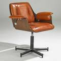 Modern swivel armchair 1970s walnut chromed and enameled metal and leather manufacturers label 32 x 32 x 27