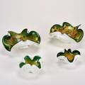 Murano four biomorphic green and white bowls with aventurine and polychrome inclusions italy unmarked largest 9 x 9