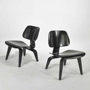 Charles and ray eames herman miller pair of lcw lounge chairs  zeeland mi 1950s ebonized wood and rubber unmarked each 26 12 x 22 x 24
