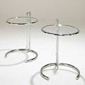 Eileen gray pair of e1027 tables 1990s chromed steel and glass unmarked each 25 12 x 20 dia