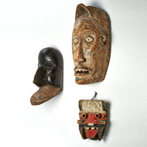 Ivory coast etc three masks two dan and one fang tribe africa 20th c largest 24 x 9 x 12