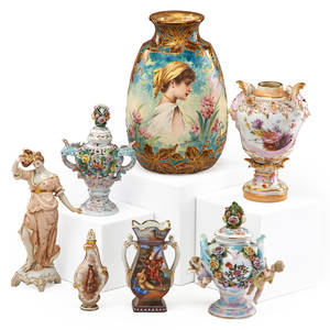German porcelain seven items late 19thearly 20th c figural urn scent bottle and bacchante by kpm vase with young girl by royal bonn and two urns and a vase by unknown makers most marked talle