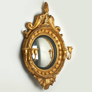 Gilt girandole mirror with flame finial supported by dolphins early 19th c 37 x 27 x 8