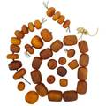 Group of large antique butterscotch amber beads 37 beads includes barrels irregular disks oblate shapes largest 39 x 30 mm 4284 gs gw