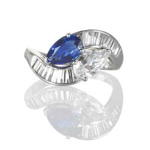 Tiffany  co diamond and sapphire platinum ring toi et moi set with pear shaped blue sapphire approx 1 ct pear shaped diamond approx 80 ct graduated baguette cut diamond channels approx