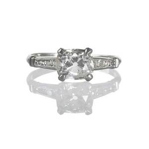 Art deco diamond platinum engagement ring old cushion cut diamond approx 15 cts horizontally prong set with diamond shoulders remaining melee approx 086 ct tw ca 1930 size 6 14 19 dwt