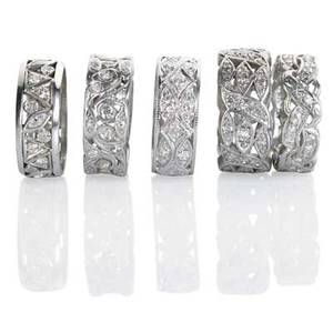 Five broad pierced eternity bands with diamonds three platinum two 14k wg circular and marquise cut diamonds approx 32 cts tw broadest 91 mm sizes 5 12  7 17 dwt property from the colle