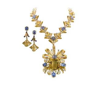 Blue and yellow sapphire diamond massive necklace 18k yg ribbon bow and textured ribbon links form a large necklace and pendant earrings 21 faceted blue sapphires approx 67 cts tw 14 faceted ye