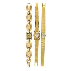 Three ladies gold mechanical bracelet watches omega 18k back wound circular with four diamonds tiffany  co 18k tank watch girard perregaux 17 jeweled movement retro bicolor 14k gold empire watch