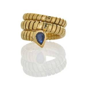 Bulgari tubogas gold and sapphire serpent ring flexible coiled 18k set with pear shaped blue sapphire italian marks for bulgari and 18k 12713 94 dwt