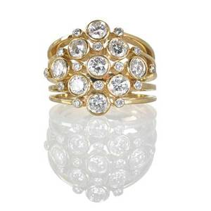Diamond and 14k yellow gold cluster ring five concentric yg bands support bezel set rbc diamond bubbles tapering shoulders diamonds approx 191 cts tw ca 1995 marked 14k size 6 66 dwt