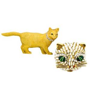Two yellow gold gemset cat brooches lifelike cat brooch with textured finish and white gold topped diamond set collar cabochon sapphire eyes marked 18 ct possibly english 1 12 x 3 stylized