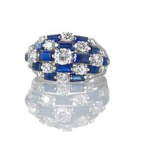 Tiffany  co diamond and sapphire platinum ring designed as a tapered bombe 19 rbc diamonds approx 110 cts tw 14 baguette cut blue sapphires approx 175 cts tw ca 1960 signed tiffany