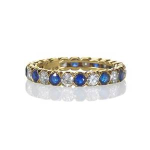 Boucheron diamond sapphire 18k gold eternity band 12 rbc diamonds approx 120 cts tw 12 rbc sapphires approx 135 cts tw marked boucheron london marks for 18k gold 1978 size 7 21 dwt