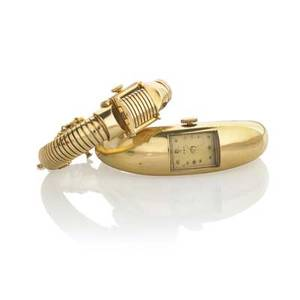 Trabert  hoffer or saks ladies gold wristwatches trabert  hoffer hinged 14k gold bracelet watch gubelin c 7012 17 jeweled swiss movement saks fifth ave 14k gold gaspipe discreet watch langer