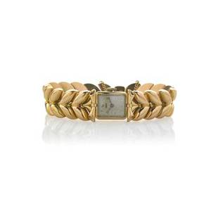 Swiss 18k yellow gold bracelet watch rectangular mechanical watch dial marked geneve bow shaped lugs and leaf shaped link bracelet ca 1955 swiss control marks 37733 6 12 x 58 29 dwt exc