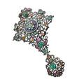 Victorian jeweled enameled silver corsage ornament built of two parts in the renaissance revival manner numerous gems in closed foil back settings include emeralds rubies spinel topaz lapis and