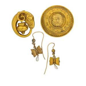 Victorian etruscan revival jewelry four pieces two 18k gold brooches a goats head and urn papal state circular brooch depict bacchus gold filled earrings suspend river pearls largest 1 58 13