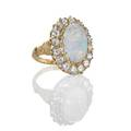 Opal and diamond oval cluster 14k gold ring white opal cabochon 1557 x 1016 x 838 mm 770 cts by formula redorangegreen color play surrounded by 16 transitional cut diamonds approx 208