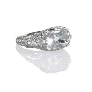 Belle epoque cushion cut diamond platinum ring oval diamond approx 20 cts laterally set in engraved platinum ca 1915 size 6 3 dwt property from the collection of gray davis boone