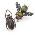 Two belle epoque jeweled insect brooches bee brooch with tigers eye quartz abdomen and thorax diamond wings ruby eyes in silver and gold pin stem with french control mark 18k 1 38 garnet and