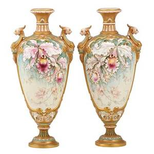 Pair of royal worcester porcelain urns handpainted floral design with gilt lion head handles late 19th c marked 15