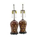 Pair of persian lacquer lamps gilt design of polo players on red ground on red ground 20th c 29