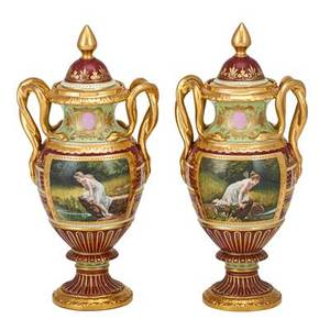 Pair of royal vienna porcelain urns handpainted reserves with gilt serpentine handles 19th c beehive mark 12 12
