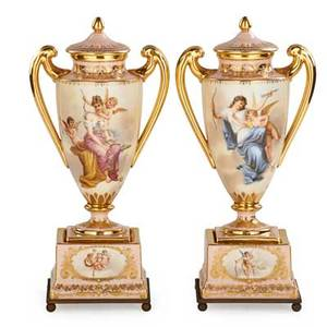 Pair of vienna porcelain urns handpainted reserves of maidens and cherubs with gilt highlights ca 1900 signed mohau 13