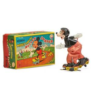 Mickey mouse tin toy roller skater with litho windup mechanism in original box by linemar with copyright of walt disney productions mid 20th c 3 x 8 18 x 4 12