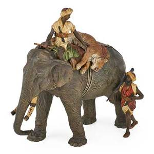 Franz xaver bergmann austrian 18611936 coldpainted bronze figure of elephant and huntsmen with tiger signed and stamped 9 12 x 9 12 x 5