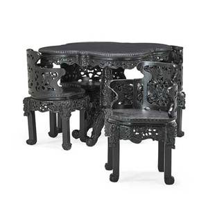 Japanese game set five ebonized hardwood table and four chairs with carved vernacular design  early 20th c 30 12 x 37 x 37