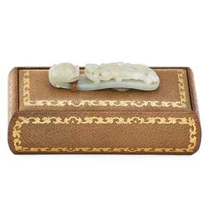 Chinese jade belthook mounted on a froelich leather cardbox ca 1900 leather stamped froelich 4 x 8 14
