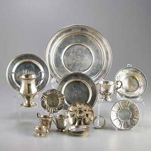 American and foreign silver holloware eighteen pieces french cup and saucer reed and barton loving cup two demitasse holders salver 10 nine dishes or plates ashtray egg cup napkin ring 20t