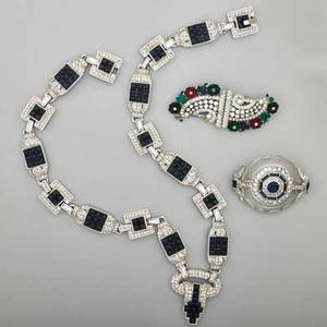 Art deco era costume jewelry three pieces circular brooch with colorless crystal with faceted edges central sapphire and diamond design cabochon sapphire and diamond geometric link necklac
