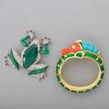 Two pieces of american costume jewelry alfred philippe for trifari enameled tree frog fur clip jelly belly body with large faceted green stone set within rhinestone encrusted frame enameled legs
