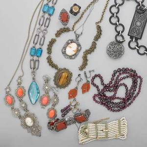 Group of costume jewelry second quarter 20th c sixteen pieces includes silver hardstone and carved shell cameos graduated faceted garnet necklace 32 and earrings drop 1 14 silver marcasite