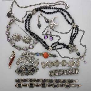 Collection of marcasite and silver jewelry twenty pieces five marcasite bracelets set with amethyst or onyx inlay four marcasite brooches three with hardstone includes one art deco double clip br