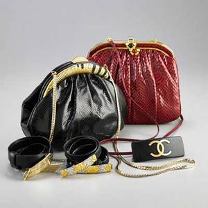 Judith leiber and chanel handbags and accessories five pieces judith leiber skin handbag red with gold tone frame red and black cabochon stone snap closure with attached skin strap judith leiber