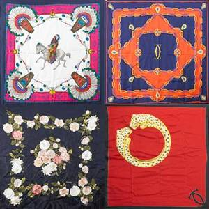 Four designer silk scarves two le must de cartier red and black orange and navy cream and pink gucci native american motif navy and pink chanel floral motif  all 34 x 34