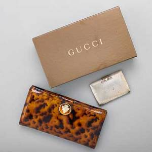 Two italian designer accessories gucci patent leather tortoise shell hysteria print wallet with snap closure gold tone hardware and black leather interior 3 34 x 7 12 in original box angele