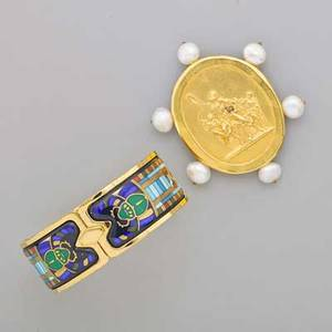 Gold tone jewelry by michaela frey two pieces hinged cuff with egyptian revival enameled design 7 gold tone brooch with freshwater pearls and embossed mythological motif after elizabeth locke